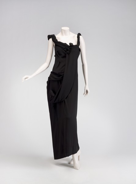 """the 1980s japanese designer yohji yamamoto """"woman's coat,"""" mid-1980s, by yohji yamamoto see more japanese designer yohji yamamoto is drawing attention in london find this pin and more on."""